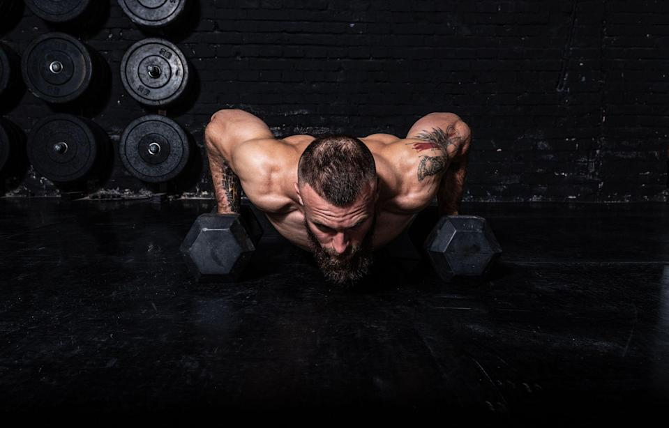 """<p>Lockdown 2.0 has arrived in force and, with it, comes the impending closure of gyms, health clubs and fitness centres around the country. Which means only one thing for your fitness efforts — it's time to bring the heat at home. This dumbbell workout, crafted by elite trainer and influencer <a href=""""https://www.menshealth.com/uk/workouts/a34124089/bradley-simmonds-upper-body-and-six-pack-workout/"""" rel=""""nofollow noopener"""" target=""""_blank"""" data-ylk=""""slk:Bradley Simmonds"""" class=""""link rapid-noclick-resp"""">Bradley Simmonds</a>, will do exactly that and then some. Over the six exercises, you'll hit all your major muscle groups — from your glutes and quads up to your chest, <a href=""""https://www.menshealth.com/uk/workouts/g754592/7-best-exercises-for-bigger-shoulders-fast/"""" rel=""""nofollow noopener"""" target=""""_blank"""" data-ylk=""""slk:shoulders"""" class=""""link rapid-noclick-resp"""">shoulders</a> and arms — to wreak havoc on your muscle fibres and encourage further growth. </p><p>What's more, it's a heart-pumper. So if you're bored of endlessly pounding the pavement, help is at hand. """"The goal is to complete as many rounds as possible in 20 minutes,"""" explains Simmonds. """"Once you can handle that, progress to 30 minutes."""" Start with 10kg dumbbells and then work up to 20kg. This is how to keep it simple, while ensuring that you're always moving forward towards the body you deserve.<br></p>"""