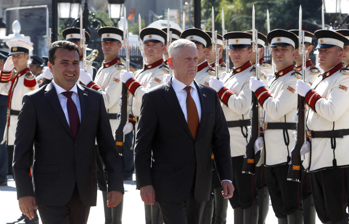 U.S. Defense Secretary James Mattis, center, accompanied by Macedonian Prime Minister Zoran Zaev, left, walk past an honor guard, upon his arrival at the government building in Skopje, Macedonia, Monday, Sept. 17, 2018. Mattis arrived in Macedonia Monday, condemning Russian efforts to use its money and influence to build opposition to an upcoming vote that could pave the way for the country to join NATO, a move Moscow opposes. (AP Photo/Boris Grdanoski)