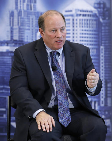 FILE- In this Oct. 23, 2013 file photo, Mike Duggan speaks in Detroit. Incoming Detroit Mayor-elect Mike Duggan takes the oath of office on Wednesday, Jan. 1, 2014 but with very limited power heading into the new year with the city in bankruptcy and under the thumb of a state-appointed emergency manager. (AP Photo/Paul Sancya, File)