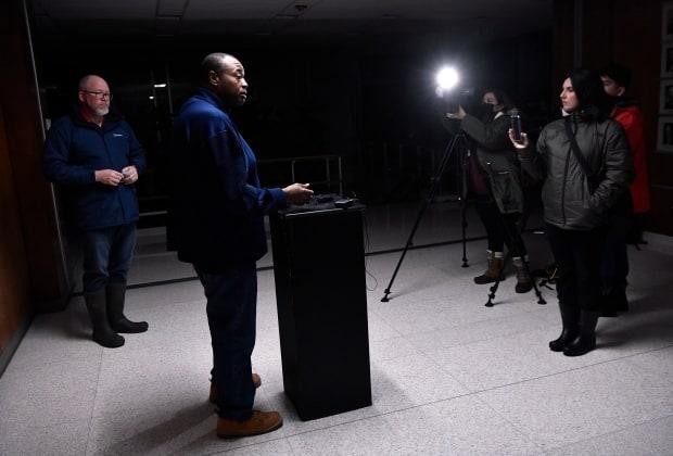 Abilene, Texas, Mayor Anthony Williams addresses the media, along with city manager Robert Hanna, during a news conference on Monday at the darkened city hall. All three of the city's water treatment plants lost power and shut down.