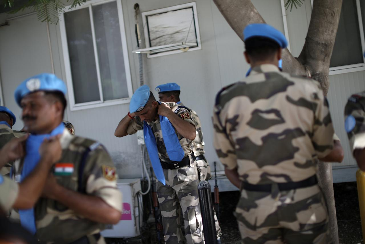 FILE PHOTO: Indian officers with the FPU (Formed Police Units) get ready before the start of the opening ceremony of the United Nations Mission for Justice support in Haiti (MINUJUSTH) in Port-au-Prince, Haiti, October 16, 2017. REUTERS/Andres Martinez Casares/File Photo