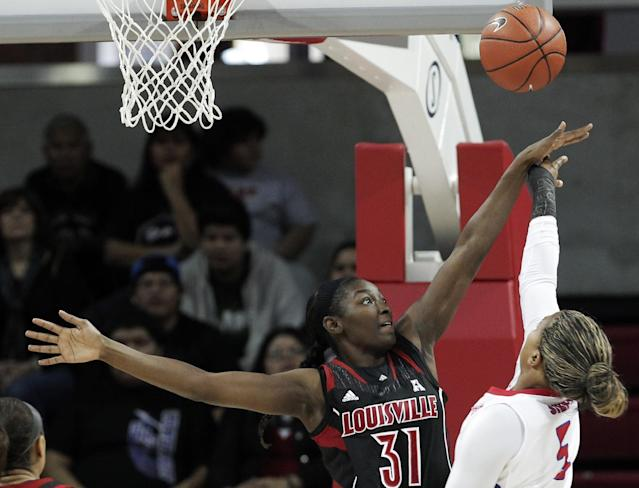 SMU forward Akil Simpson (5) attempts to shoot as Louisville's Asia Taylor (31) defends in the first half of an NCAA college basketball game on Sunday, Jan. 19, 2014, in Dallas. (AP Photo/Brandon Wade)