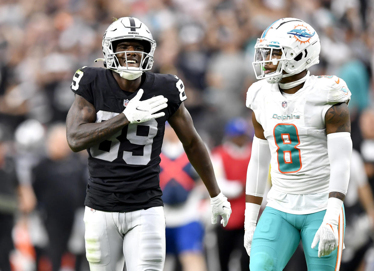 LAS VEGAS, NEVADA - SEPTEMBER 26: Bryan Edwards #89 of the Las Vegas Raiders reacts during overtime as Jevon Holland #8 of the Miami Dolphins looks on at Allegiant Stadium on September 26, 2021 in Las Vegas, Nevada. (Photo by Chris Unger/Getty Images)
