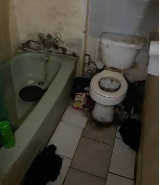 Filthy bathroom in a rental house inspected by city officials.