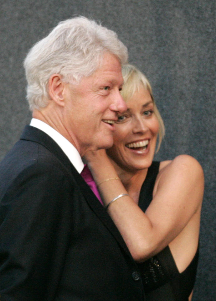 U.S. actress Sharon Stone poses with former US President Bill Clinton before the presentation of a one million dollar cheque for the William J Clinton foundation after an Aids Charity Gala Dinner in Schoenbrunn castle in Vienna May 24, 2007. (REUTERS/Leonhard Foeger)