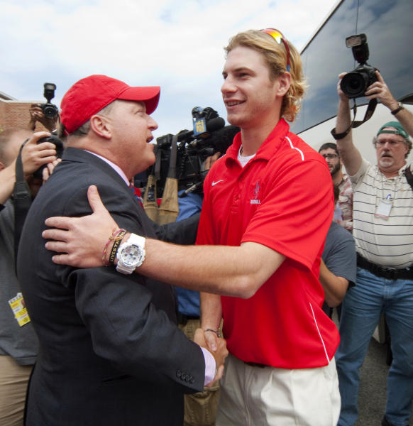 In this photo provided by Stony Brook University Communications, university President Samuel L. Stanley, Jr., left, welcomes Travis Jankowski home from Baton Rouge, La., Monday, June 11, 2012, in Stony Brook, N.Y. The Seawolves upset college baseball's powerhouse, the LSU Tigers, in the NCAA super regional competition Sunday to earn a berth in the College World Series. (AP Photo/Stony Brook University Communications, John Griffin)