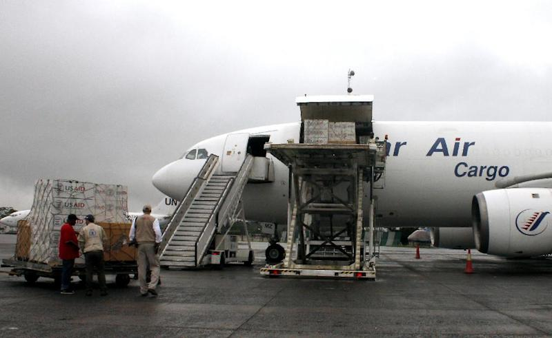 Personnel unload medical equipment sent by USAID to fight Ebola in Liberia at Roberts International Airport near Monrovia on August 24, 2014
