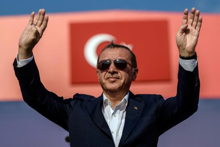 Turkish President Recep Tayyip Erdogan greets supporters on August 7, 2016 in Istanbul during a rally against failed military coup on July 15