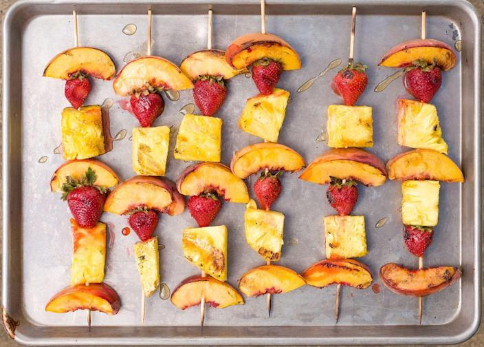 """<p>Because food is always more fun on a stick.</p><p>Get the recipe from <a href=""""https://www.delish.com/cooking/recipe-ideas/recipes/a43683/grilled-summer-fruit-kebabs-recipe/"""" rel=""""nofollow noopener"""" target=""""_blank"""" data-ylk=""""slk:Delish"""" class=""""link rapid-noclick-resp"""">Delish</a>.</p>"""
