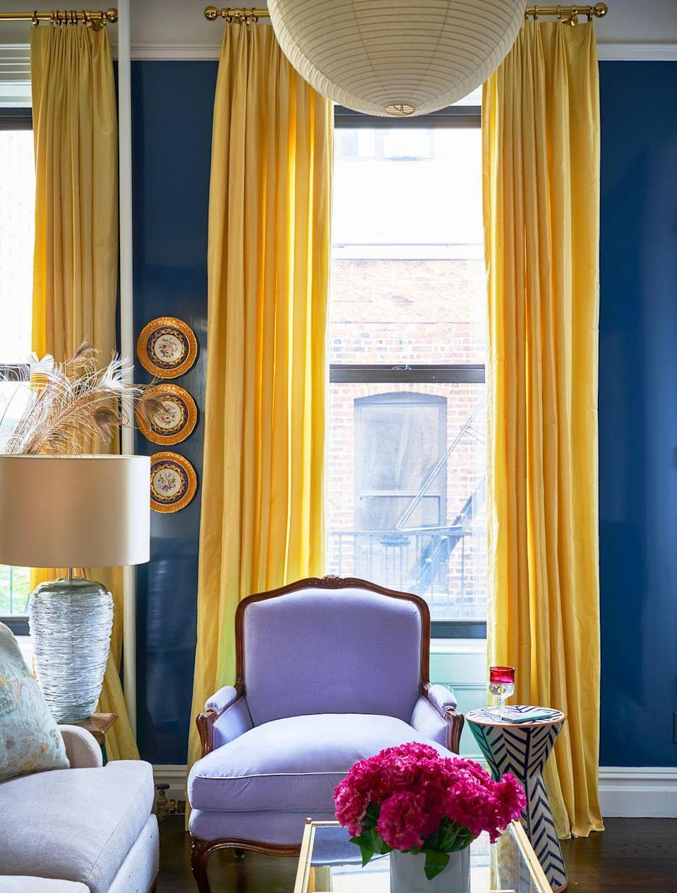 """<p>The deep blue paint alone is a bold color choice for this azure living room by <a href=""""https://www.housebeautiful.com/design-inspiration/house-tours/a26767482/kate-reid-colorful-manhattan-apartment/"""" rel=""""nofollow noopener"""" target=""""_blank"""" data-ylk=""""slk:Kate Reid"""" class=""""link rapid-noclick-resp"""">Kate Reid</a>, but the high-gloss finish adds some extra punch. It's basically the color of wanderlust right in your own home: It'll make you feel like you're on vacation, even if the closest you're getting to an island escape is your laptop's screensaver (sigh).</p>"""