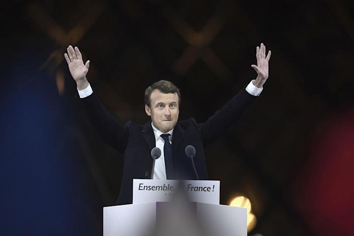 <p>MAY 7, 2017 – French president-elect Emmanuel Macron greets supporters as he arrives to deliver a speech in front of the Pyramid at the Louvre Museum in Paris after the second round of the French presidential election.<br> Emmanuel Macron was elected French president on May 7, 2017 in a resounding victory over far-right Front National (FN – National Front) rival after a deeply divisive campaign. (Photo: Eric Feferberg/AFP/Getty Images) </p>