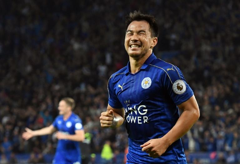 Leicester City's Japanese striker Shinji Okazaki celebrates after scoring his and Leicester's second goal during the English League Cup third round game against Chelsea in Leicester, central England on September 20, 2016