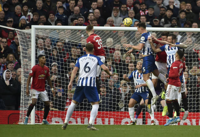 Brighton's Lewis Dunk, fourth right, scores his side's opening goal during the English Premier League soccer match between Manchester United and Brighton and Hove Albion, at the Old Trafford stadium in Manchester, England, , Sunday, Nov. 10, 2019. (AP Photo/Rui Vieira)