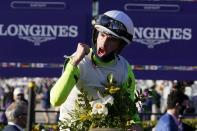 Florent Geroux celebrates after riding Monomoy Girl to win the Breeders' Cup Distaff horse race at Keeneland Race Course, in Lexington, Ky., Saturday, Nov. 7, 2020. (AP Photo/Michael Conroy)