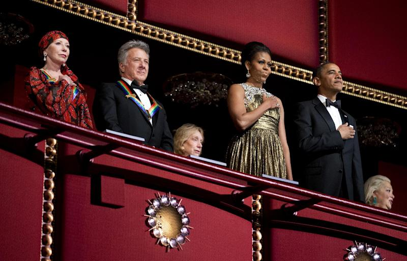 President Barack Obama, right, and first lady Michelle Obama, second from right, with the 2012 Kennedy Center Honors recipients, ballerina Natalia Makarova, left, and actor and director Dustin Hoffman, stand as the National Anthem is played during the Kennedy Center Honors Gala at the Kennedy Center in Washington, Sunday, Dec. 2, 2012. (AP Photo/Manuel Balce Ceneta)