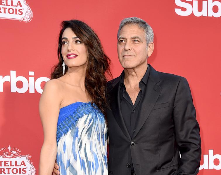 George Clooney and his wife Amal Clooney plan to march in support of the survivors of last week's mass shooting at a Florida high school.