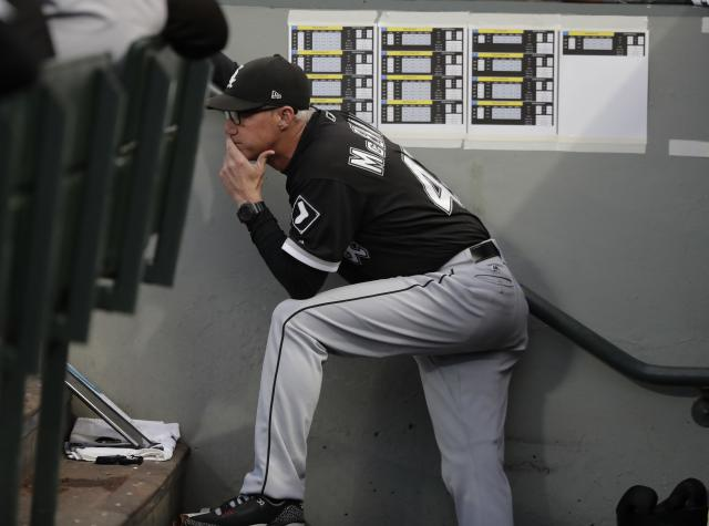 Chicago White Sox bench coach Joe McEwing stands in the dugout during a baseball game against the Seattle Mariners, Friday, July 20, 2018, in Seattle. (AP Photo/Ted S. Warren)