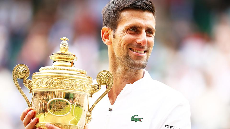 Novak Djokovic, pictured here celebrating with the trophy after winning his sixth Wimbledon title.
