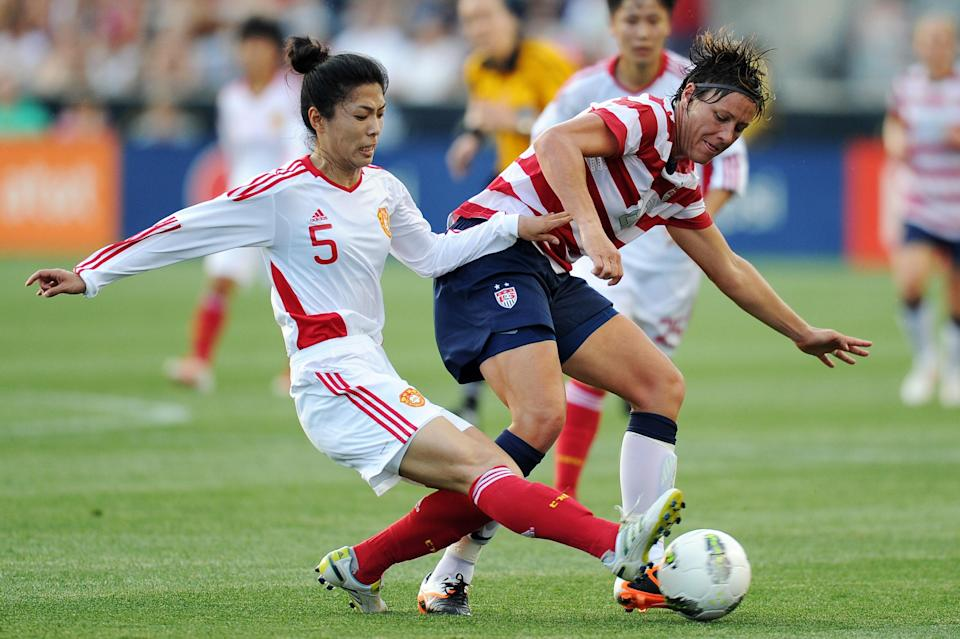 Wang Dongni #5 of China and Abby Wambach #20 battle for the ball at PPL Park on May 27, 2012 in Chester, Penn. (Photo by Drew Hallowell/Getty Images)