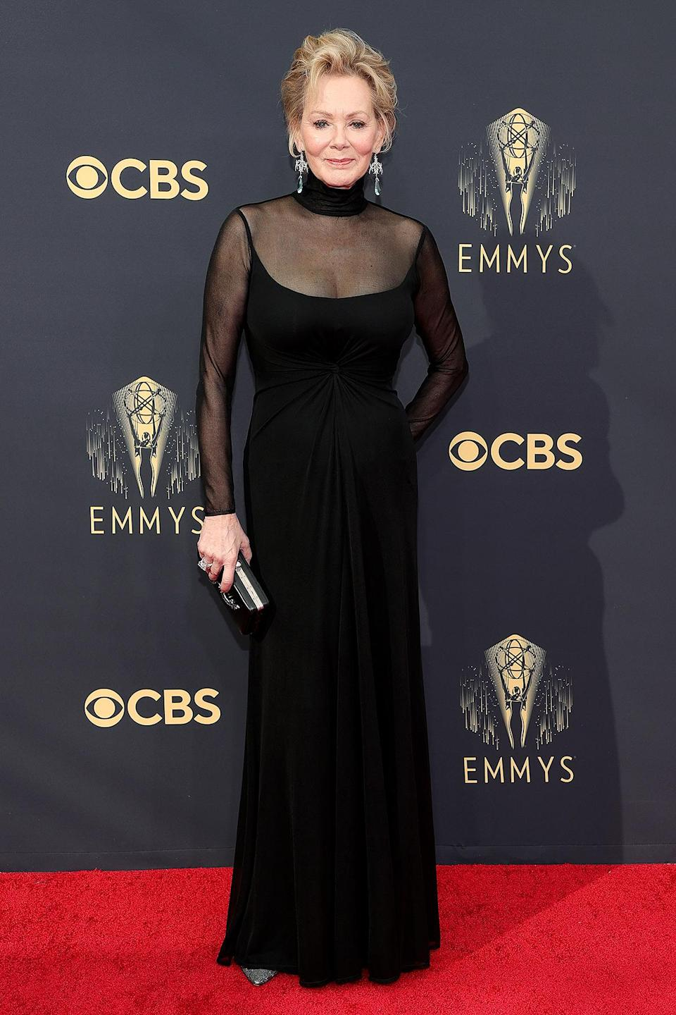<p>in an elegant Ralph Lauren Collection turtleneck gown, with sheer sleeves and neckline.</p>