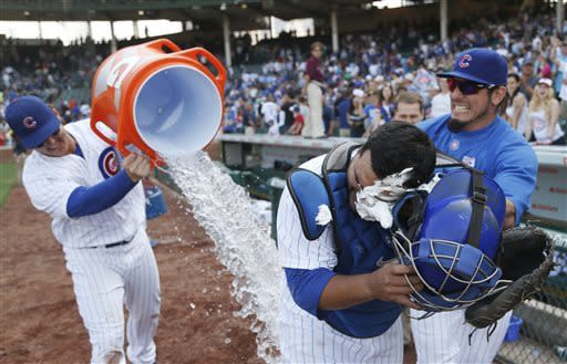 Chicago Cubs' Anthony Rizzo, left, dumps ice water on catcher Dioner Navarro, while Matt Garza, right, hits him in the face with a shaving cream pie as they celebrate the Cubs' 9-3 win over the Chicago White Sox in an interleague baseball game Wednesday, May 29, 2013, in Chicago. Navarro hit three home runs in the game. (AP Photo/Charles Rex Arbogast)