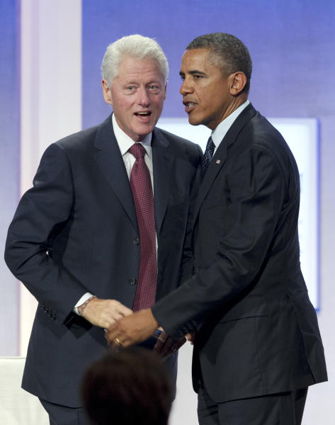 Former President Bill Clinton, left, and President Barack Obama are seen on stage at the Clinton Global Initiative, Tuesday, Sept. 24, 2013 in New York. The initiative was started by former President Bill Clinton to act as a forum where leaders from all over the world can discuss and develop solutions to global issues. (AP Photo/Mark Lennihan)