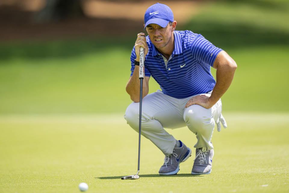 Rory McIlroy lines up his putt on the third hole during the first round of the Wells Fargo Championship golf tournament at Quail Hollow Club on Thursday, May 6, 2021, in Charlotte, N.C. (AP Photo/Jacob Kupferman)
