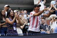 Irene Exevea, left, mother of Leylah Fernandez, of Canada, and Duglas Cordero, Fernandez's fitness coach, right, cheer on Leylah Fernandez during the quarterfinals of the US Open tennis championships against Elina Svitolina, of Ukraine, Tuesday, Sept. 7, 2021, in New York. (AP Photo/Elise Amendola)