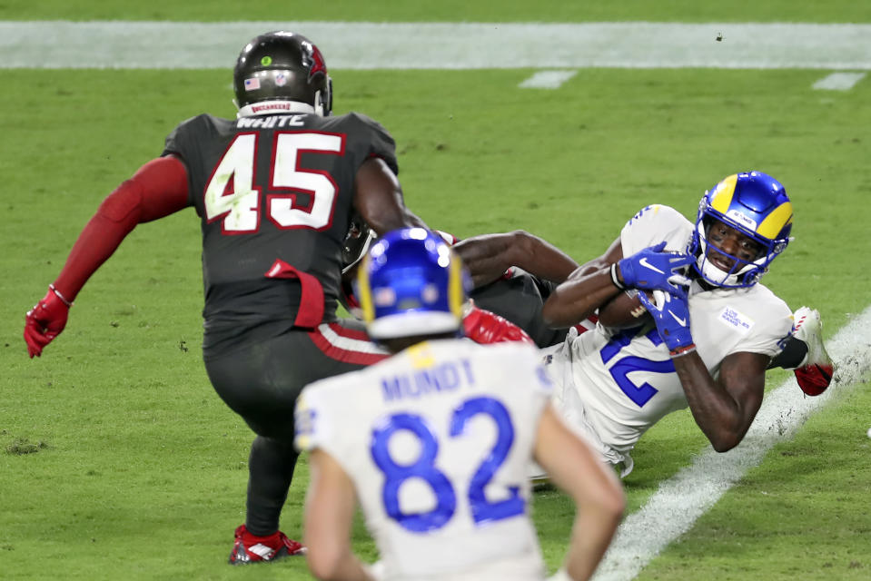 Los Angeles Rams wide receiver Van Jefferson (12) beats Tampa Bay Buccaneers inside linebacker Lavonte David (54) to score on a 7-yard touchdown reception during the first half of an NFL football game Monday, Nov. 23, 2020, in Tampa, Fla. (AP Photo/Mark LoMoglio)
