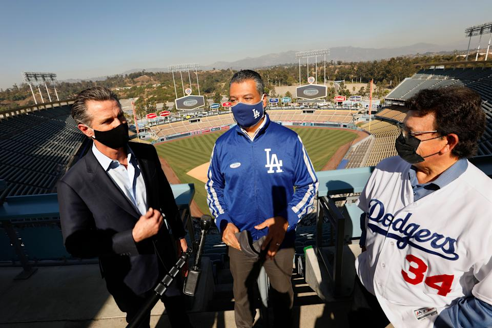 California Secretary of State Alex Padilla (center) celebrates the L.A. Dodgers' World Series win with Newsom (left). Padilla is widely viewed as a front-runner to replace Sen. Harris. (Photo: Carolyn Cole/Getty Images)