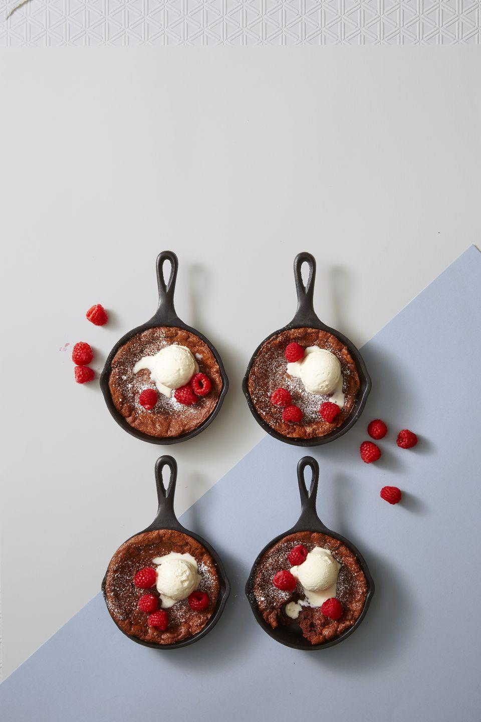 """<p>Your cast-iron skillet was always multi-functional ... but brownies? Who knew? Top with berries and generous scoops of ice cream to add to the fun.</p><p><a class=""""link rapid-noclick-resp"""" href=""""https://www.amazon.com/Lodge-LMS3-Miniature-Skillet/dp/B000LXA9YI/?tag=syn-yahoo-20&ascsubtag=%5Bartid%7C10055.g.4249%5Bsrc%7Cyahoo-us"""" rel=""""nofollow noopener"""" target=""""_blank"""" data-ylk=""""slk:SHOP MINI SKILLETS"""">SHOP MINI SKILLETS</a></p><p><em><a href=""""https://www.goodhousekeeping.com/food-recipes/dessert/a42823/molten-chocolate-skillet-brownies-recipe/"""" rel=""""nofollow noopener"""" target=""""_blank"""" data-ylk=""""slk:Get the recipe for Molten Chocolate Skillet Brownies »"""" class=""""link rapid-noclick-resp"""">Get the recipe for Molten Chocolate Skillet Brownies »</a></em> </p>"""