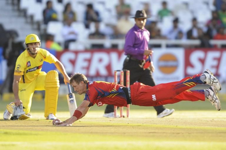 Chris Morris (R) of the Highveld Lions saves a certain foundry off his own bowling on October 16, 2012 during Match 7 of the Champions League T20 (CLT20) between the Chennai Super Kings (India) and the Highveld Lions (South Africa) at  the Newlands Cricket Stadium in Cape Town. AFP PHOTO / Roger Sedres