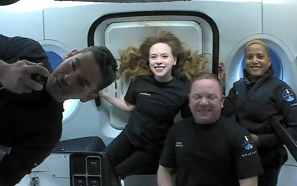 Inspiration4 crew (L-R) Jared Isaacman, Hayley Arceneaux, Christopher Sembroski and Sian Proctor in orbit - AFP