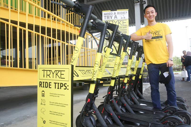 E-scooter sharing service Tryke's founder Timothy Wong poses for a photo with the e-scooters at RekaScape in Cyberjaya November 22, 2019.