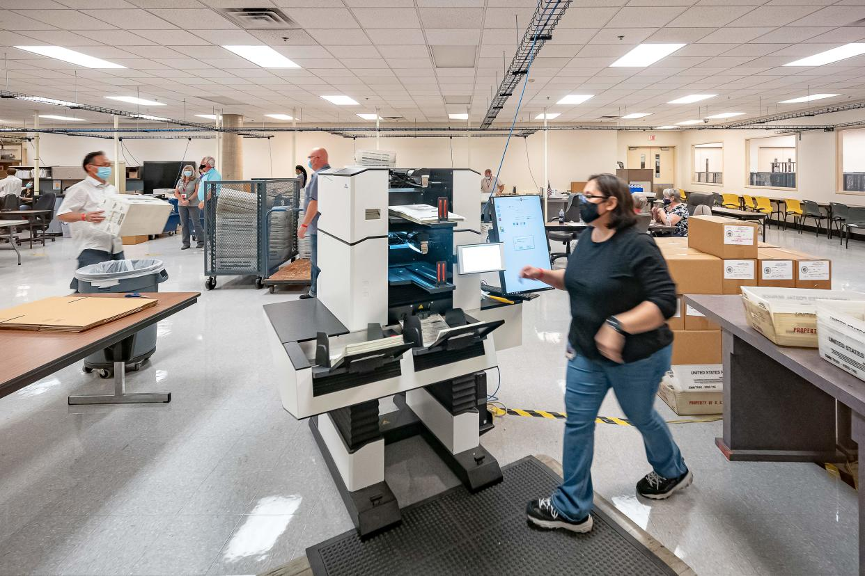 Ballots are counted at the Maricopa County Election Department