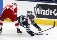 Columbus Blue Jackets forward Nathan Gerbe, right, falls in front of Detroit Red Wings forward Sam Gagner during the first period an NHL hockey game in Columbus, Ohio, Friday, May 7, 2021. (AP Photo/Paul Vernon)