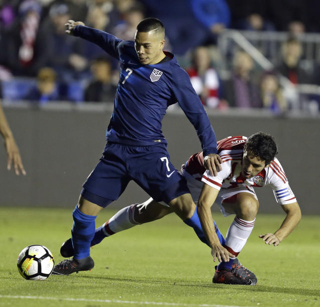 United States' Bobby Wood (7) chases the ball with Paraguay's Cristian Riveros during the first half of an international friendly soccer match in Cary, N.C., Tuesday, March 27, 2018. (AP Photo/Gerry Broome)