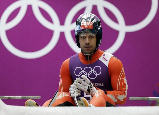 Bruno Banani of Tonga prepares to start a run during a training session for the men's singles luge at the 2014 Winter Olympics, Thursday, Feb. 6, 2014, in Krasnaya Polyana, Russia. (AP Photo/Dita Alangkara)