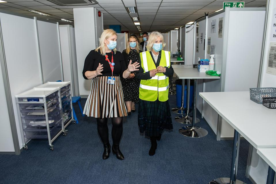 Camilla chats to Pippa Nightingale, chief nursing officer for Chelsea and Westminster Hospital NHS Foundation Trust, as she tours the Wembley vaccination centre (Royal Voluntary Service/PA)