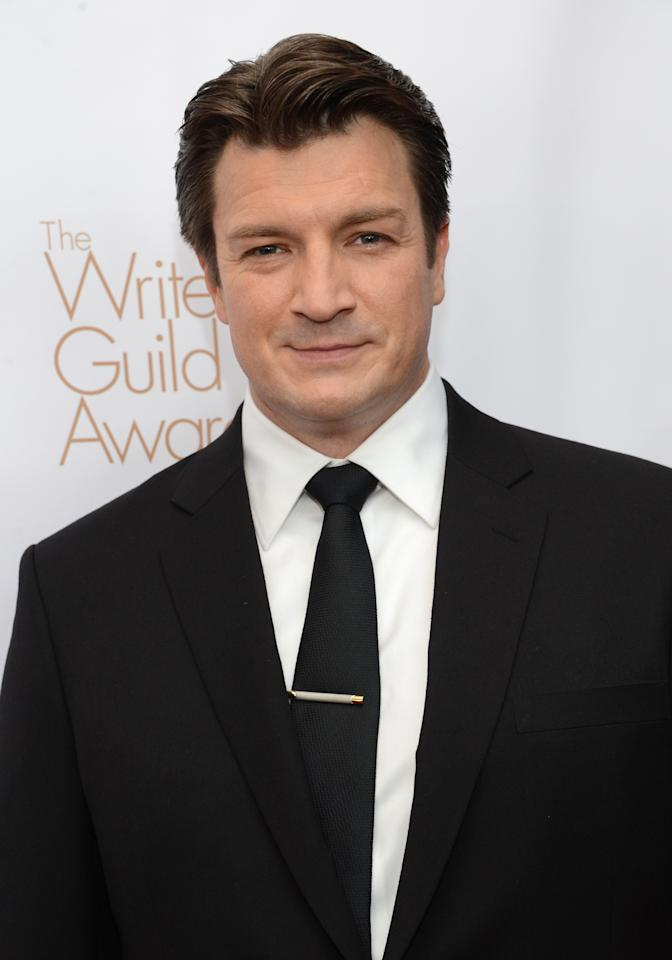 LOS ANGELES, CA - FEBRUARY 17:  Host Nathan Fillion arrives at the 2013 WGAw Writers Guild Awards at JW Marriott Los Angeles at L.A. LIVE on February 17, 2013 in Los Angeles, California.  (Photo by Jason Kempin/Getty Images for WGAw)