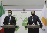 Cypriot Foreign Minister Nicos Christodoulides, right, and Italian Foreign Minister Luigi Di Maio talk to the media during a press conference after their meeting at the Foreign Ministry house in Nicosia, Cyprus, Tuesday March 9, 2021. Maio is in Cyprus for one-day visit. (Yiannis Kourtoglou/Pool via AP)