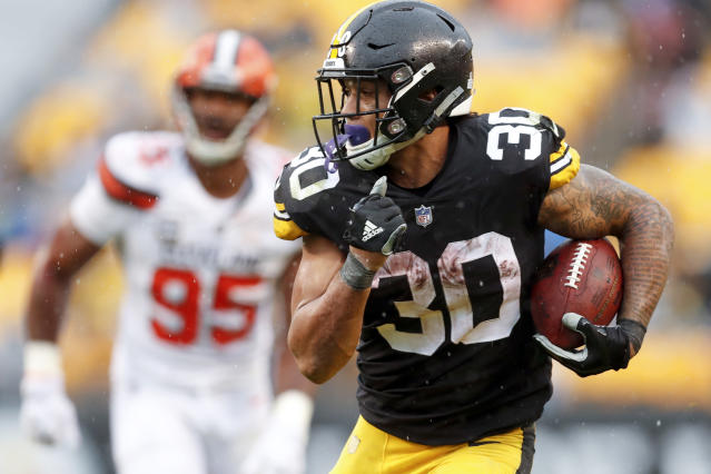 FILE - In this Sunday, Oct. 28, 2018, file photo, Pittsburgh Steelers running back James Conner (30) breaks away from Cleveland Browns defensive end Myles Garrett (95) for a touchdown in the second half of an NFL football game in Pittsburgh. Conner is thriving in LeVeon Bell's absence. Hes second in the league in total yards and is the first player in team history to have 10 total touchdowns through eight games. (AP Photo/Don Wright, File)