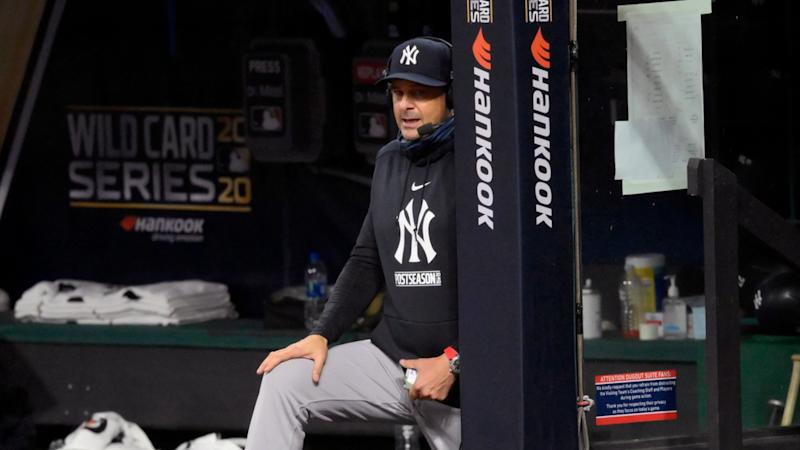 Aaron Boone gets interviewed from dugout during AL Wild Card Round