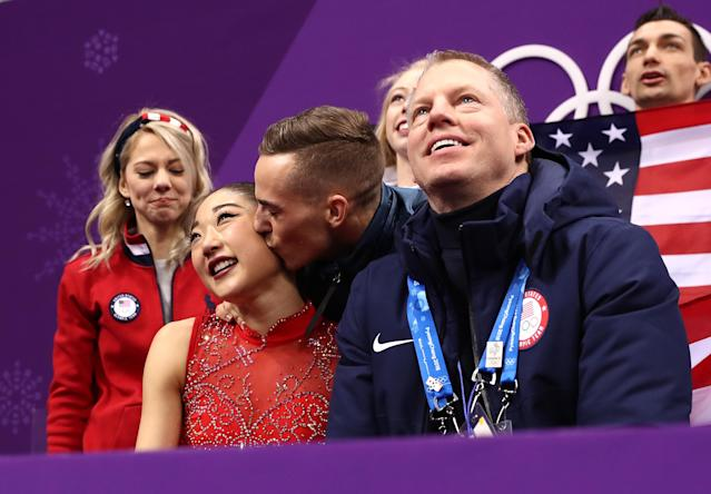 <p>Rippon gives fellow Olympian Mirai Nagasu a kiss after her successful skate during the team competition. Nagasu successfully landed a triple axel, the first American to do so at the Olympics, to help the Americans earn the bronze. </p>