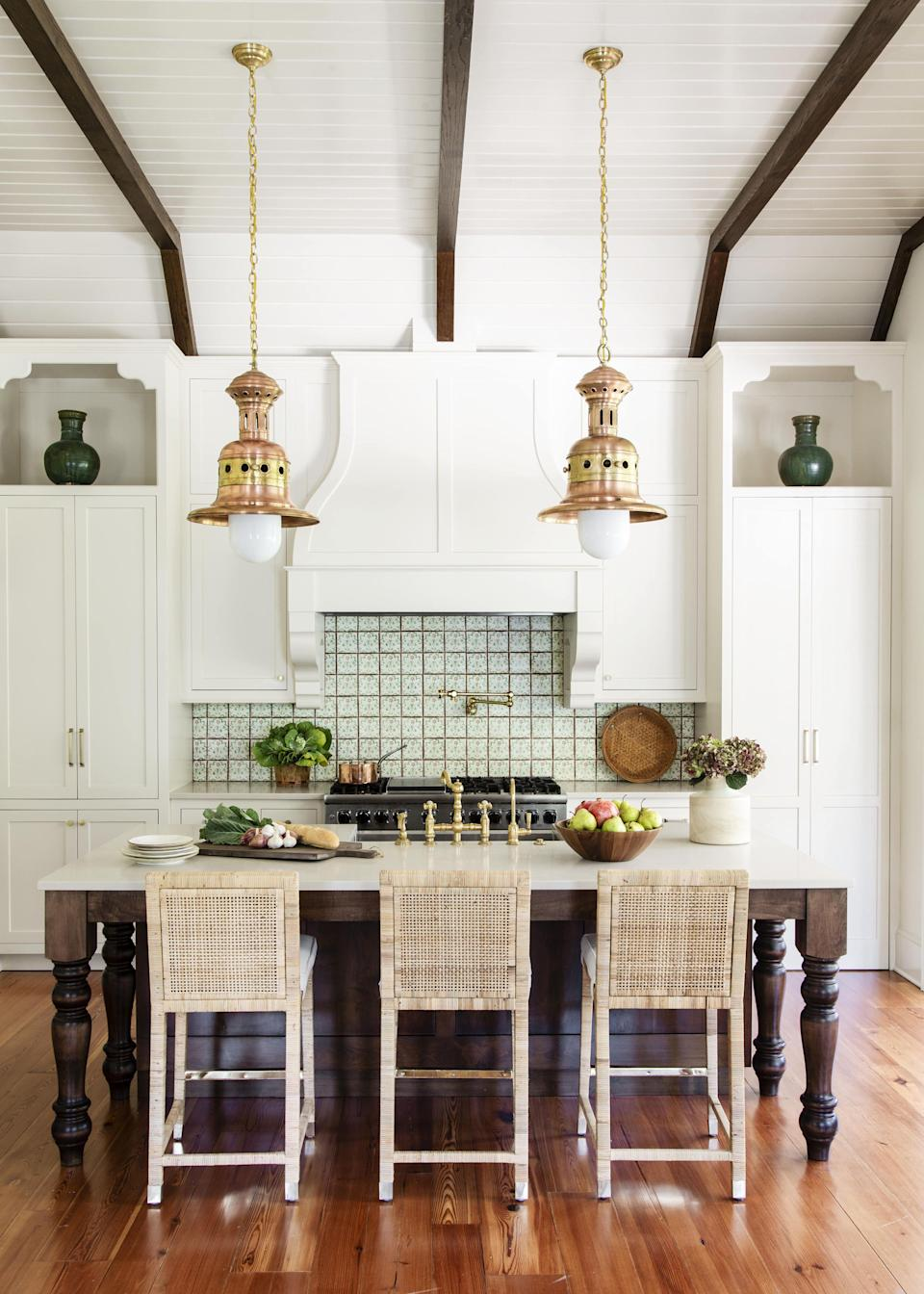"<p>There are few better ways to give your kitchen a simple yet impactful upgrade than new light fixtures. Designers anticipate investment in low-lift projects like hardware, light fixtures, and finishes will be a major <a href=""https://www.veranda.com/decorating-ideas/g35046179/kitchen-trends-2021/"" rel=""nofollow noopener"" target=""_blank"" data-ylk=""slk:kitchen design trend"" class=""link rapid-noclick-resp"">kitchen design trend </a>this year, which can make your kitchen feel brand-new without living in a construction zone for months. Lighting is also especially important in the<a href=""https://www.veranda.com/decorating-ideas/g34955481/modern-kitchens/"" rel=""nofollow noopener"" target=""_blank"" data-ylk=""slk:modern kitchen"" class=""link rapid-noclick-resp""> modern kitchen</a>, as this space has truly become the heart of the home again: it serves as a place to catch up on email, finish homework, call a friend, mix up a cocktail, oh, and make most of the week's meals. <a href=""https://www.veranda.com/home-decorators/a1081/lighting-mistakes/"" rel=""nofollow noopener"" target=""_blank"" data-ylk=""slk:Choosing the right lighting"" class=""link rapid-noclick-resp"">Choosing the right lighting</a> is essential not only making your kitchen more beautiful but to set a cozy and warm mood that makes your late-night baking ventures and early morning coffee rituals feel more luxurious and inviting</p><p>The following kitchen light fixture ideas offer some of our favorite ways to zhush up your lighting game from some of the world's best designers. Just be sure to invest in the right bulbs to ensure your space feels happy and calming instead of sterile and overly bright!</p>"