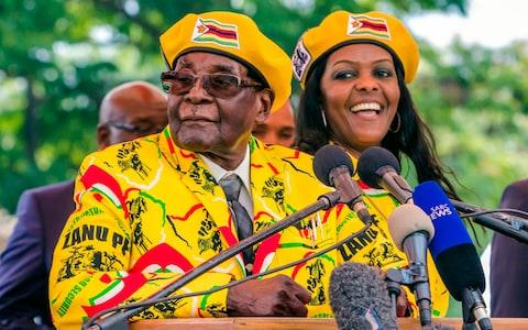 Robert Mugabe addresses party members and officials gathered at his party headquarters to show support to Grace Mugabe becoming the party's next vice president - Credit: AFP PHOTO / Jekesai NJIKIZANA