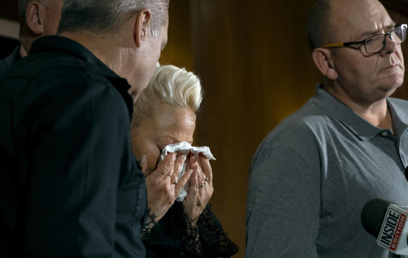 Charlotte Charles, mother of Harry Dunn, who died after his motorbike was involved in an August 2019 accident in Britain with Anne Sacoolas, wife of an American diplomat, wipes her eyes at a news conference as she is joined by family members and supporters Monday, Oct. 14, 2019, in New York. The family is seeking answers after Sacoolas returned to the United States after being granted diplomatic immunity following the crash. (AP Photo/Craig Ruttle)