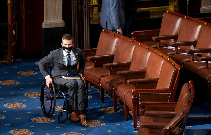 Congressman Madison Cawthorn of North Carolina will attend Joe Biden's inauguration after spending weeks questioning his legitimacy as president-elect. (Getty Images)