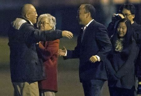 Kenneth Bae reunites with his family at U.S. Air Force Joint Base Lewis-McChord in Fort Lewis, Washington