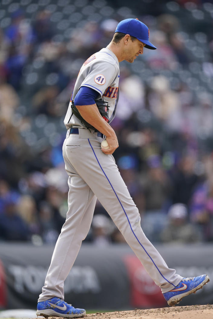 New York Mets starting pitcher Jacob deGrom reacts after giving up a solo home run to Colorado Rockies' Raimel Tapia during the fifth inning of the first baseball game of a doubleheader Saturday, April 17, 2021, in Denver. (AP Photo/David Zalubowski)